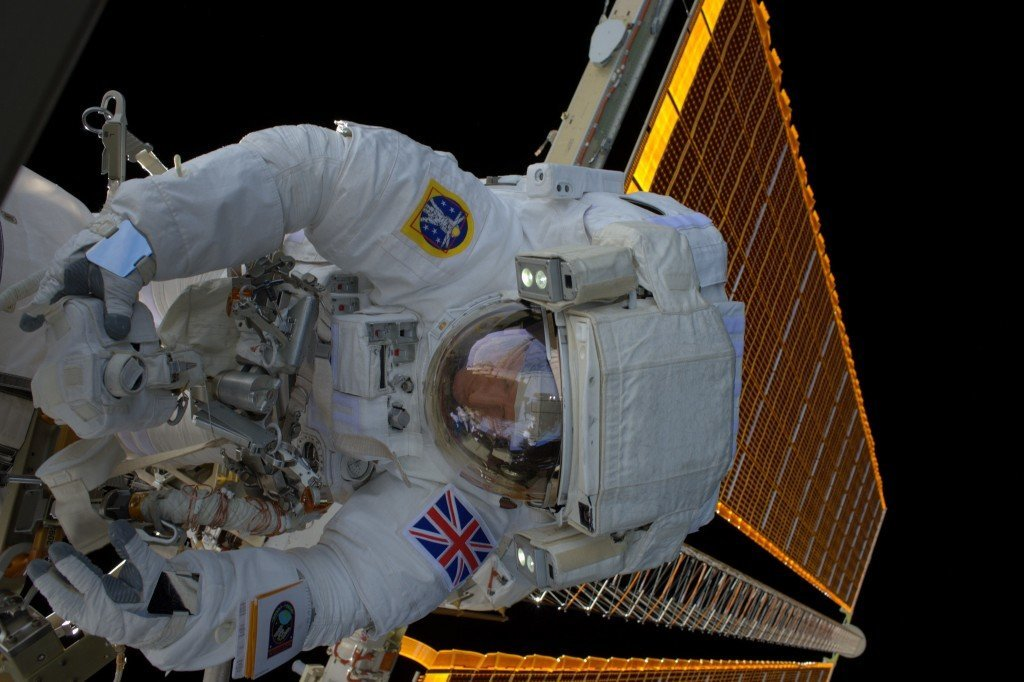 Tim steps outside the ISS, is disappointed by lack of fresh air   Image: ESA